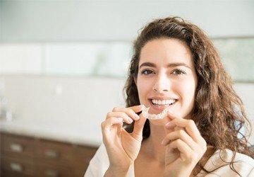 woman holding Invisalign
