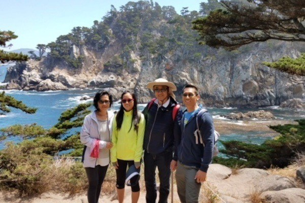 Dr. Yu and family outdoors