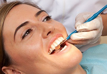 Melbourne Dental Services woman receiving dental exam