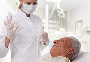 Relaxed senior man in dental exam chair