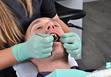 Relaxed man receiving dental care