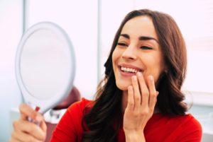 Woman admiring her dental implants